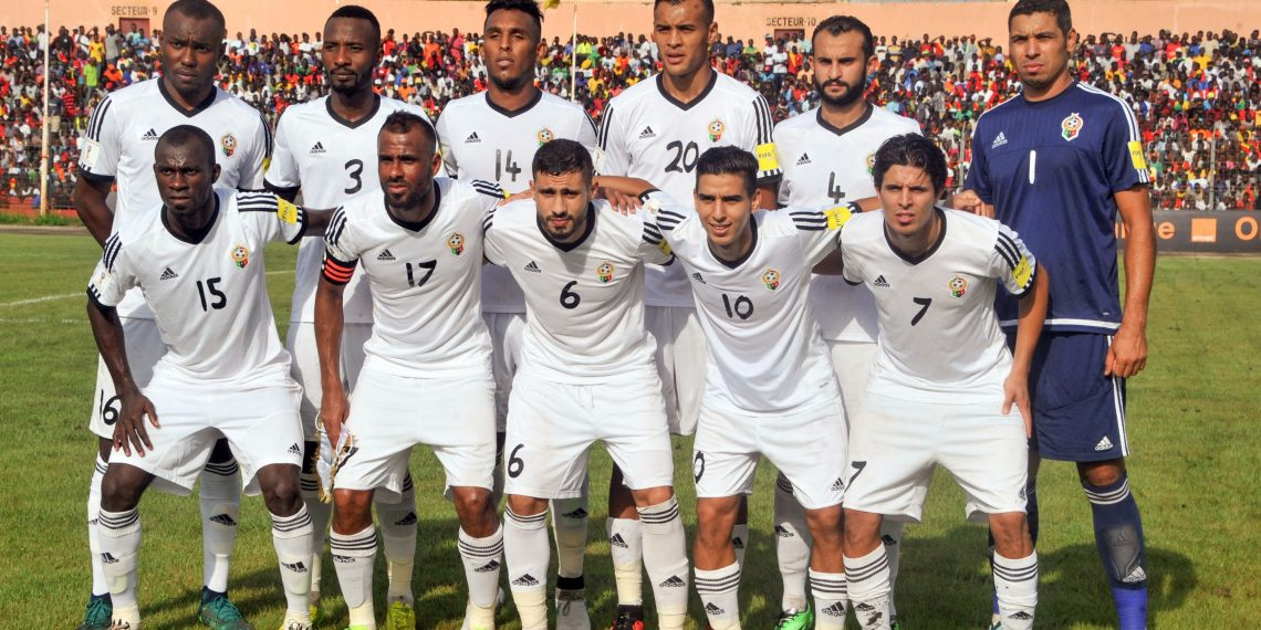 Libya's national football team players Muhammad Nashnoush, Sand Msoud, Moath Abood, Motasem Sabbou, Abdulrhman Ramadhan Khalleefah, Moayad Allafi, Elmutasem El Masrati, Bader Hasan Ahmed, Anis Mohamed Saltou, Mohammed Al-Tabbal, and Mohamed Abrahim Aleyat pose for a team photo prior to the 2018 FIFA World Cup qualifying football match between Guinea and Libya at the Stade du 28 Septembre in Conakry on August 31, 2017. / AFP PHOTO / CELLOU BINANI
